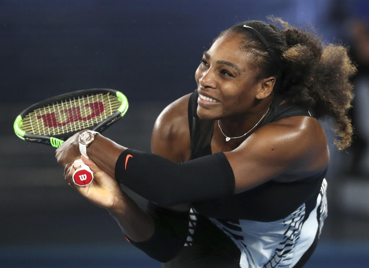 FILE - In this Saturday, Jan. 28, 2017 file photo, United States' Serena Williams makes a backhand return to her sister Venus during the women's singles final at the Australian Open tennis championships in Melbourne, Australia. Olympic swimmer Michael Phelps and Oklahoma City Thunder star Russell Westbrook are among the finalists for best male athlete at the ESPY Awards. Tennis star Serena Williams and gymnast Simone Biles are two of the finalists for best female athlete. (AP Photo/Aaron Favila, File)