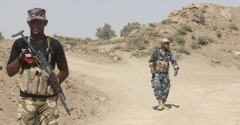Iraqi security forces and volunteers take part in a mission to secure an area from militants of the Islamic State, formerly known as the Islamic State in Iraq and the Levant (ISIL), in Udhaim district, north of Baghdad, August 6, 2014. Iraqi forces said they were fully in control of a district, northeast of Baghdad, after repelling repeated attacks by insurgents of the Islamic State to capture the area and continue their push towards the capital. Picture taken August 6, 2014. REUTERS/Stringer (IRAQ - Tags: CIVIL UNREST POLITICS CONFLICT MILITARY)