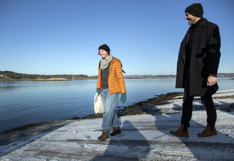 "Lisa Enroth, left, prepares to depart for the island of Hamneskar, western Sweden as she speaks with Jonas Holmberg, creative director of Goteborg Film Festival, on Saturday, Jan. 30, 2021. The 44th Goteborg film festival opened this weekend in a mostly virtual format but an emergency ward nurse from Sweden was selected among 12,000 volunteers to spend a week on an isolated island in the North Sea with for only companionship the events' entire movie selection. Lisa Enroth said the opportunity gave her ""time to reflect"" after a busy year amid the COVID pandemic. (AP Photo/Thomas Johansson)"