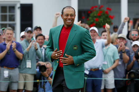 FILE PHOTO: Golf - Masters - Augusta National Golf Club - Augusta, Georgia, U.S. - April 14, 2019 - Tiger Woods of the U.S. wears the green jacket as he celebrates after winning the 2019 Masters. REUTERS/Brian Snyder