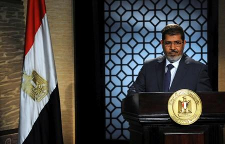 FILE PHOTO -  Muslim Brotherhood's president-elect Mohamed Mursi speaks during his first televised address to the nation in Cairo