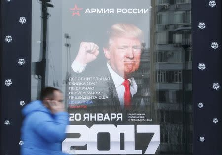 "A pedestrian walks past the store ""Army of Russia"", located opposite the U.S. embassy, with an image of U.S. President-elect Donald Trump seen on the advertising board, in Moscow, Russia, January 20, 2017. REUTERS/Sergei Karpukhin"