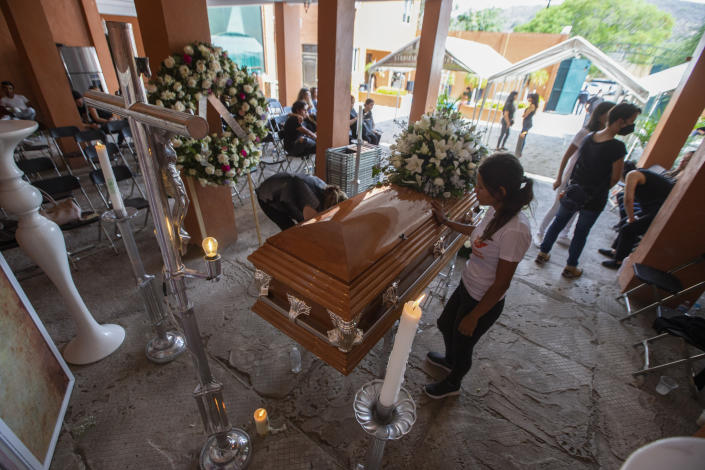 Friends and family mourn during the wake of mayoral candidate Alma Barragan in Moroleon, Mexico, Wednesday, May 26, 2021. Barragan was killed Tuesday while campaigning for the mayorship of the city of Moroleon, in violence-plagued Guanajuato state. (AP Photo/Armando Solis)