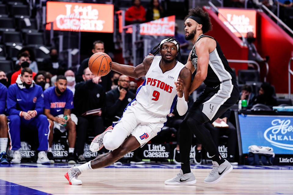Detroit Pistons forward Jerami Grant (9) is defended by San Antonio Spurs guard Derrick White (4) during the second half of a preseason game at Little Caesars Arena in Detroit on Wednesday, Oct. 6, 2021.