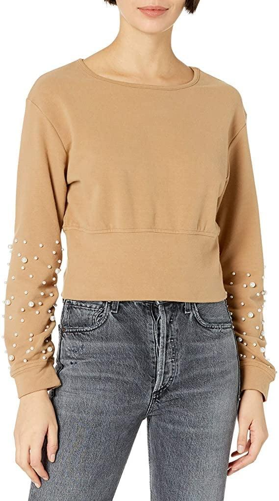 <p><span>KENDALL + KYLIE Pearl Embellished Sweatshirt With Back Cut-Out</span> ($59)</p>