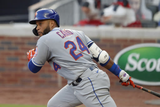 New York Mets' Robinson Cano drives in a run with a base hit in the third inning of a baseball game against the Atlanta Braves, Monday, Aug. 3, 2020, in Atlanta. (AP Photo/John Bazemore)