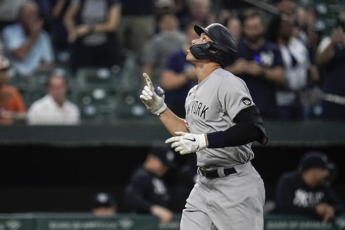 New York Yankees' Aaron Judge gestures after hitting a two-run home run off Baltimore Orioles starting pitcher Alexander Wells during the first inning of a baseball game, Tuesday, Sept. 14, 2021, in Baltimore. (AP Photo/Julio Cortez)