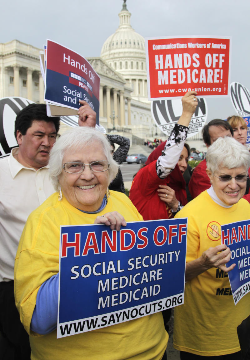 Sue Ward, of Upper Marlboro, Md., left, a member of the National Committee to Preserve Social Security and Medicare, joins members of Congress and union members on Capitol  Hill in Washington, Wednesday, Oct. 26, 2011, to voice their opposition to potential cuts in Medicare, Medicaid, and Social Security benefits as the deficit supercommittee looks for cuts ways to reduce government spending in all areas.   (AP Photo/J. Scott Applewhite)