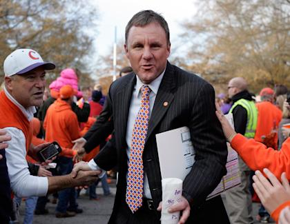 CLEMSON, SC - NOVEMBER 29: Offensive Coordinator Chad Morris of the Clemson Tigers greets fans as he enters the stadium prior to their game against the South Carolina Gamecocks. (Photo by Tyler Smith/Getty Images)