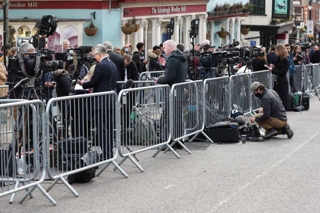 Members of the media gather outside Windsor Castle