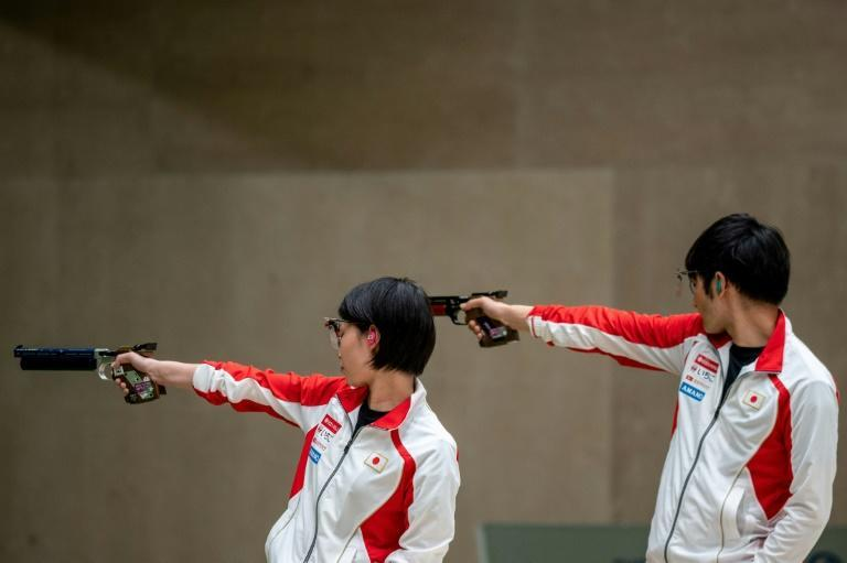 Friendly fire: Satoko Yamada (L) and Seiji Morikawa of Japan compete in 10m pistol test event in Tokyo in May