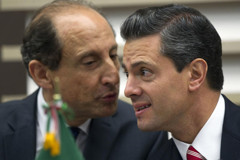 Mexico's President-elect Enrique Pena Nieto, right, listens to Paulo Skaf, president of the Sao Paulo's Industries Federation, during a meeting with businessmen, in Sao Paulo, Brazil, Wednesday, Sept. 19, 2012. (AP Photo/Andre Penner)