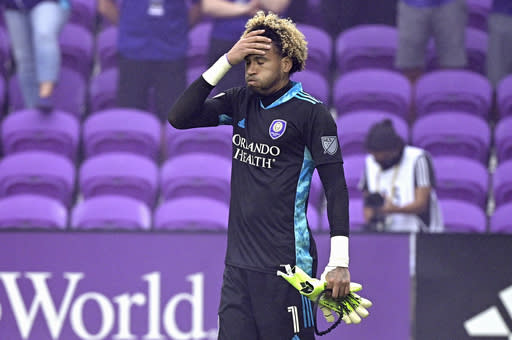 Orlando City goalkeeper Pedro Gallese (1) reacts after receiving a red card, and getting ejected during the penalty kicks period of overtime of an MLS soccer playoff match against the New York City FC, Saturday, Nov. 21, 2020, in Orlando, Fla. (AP Photo/Phelan M. Ebenhack)