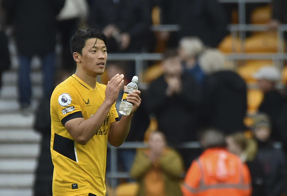 Wolverhampton Wanderers' Hwang Hee-chan applauds supporters at the end of the English Premier League soccer match between Wolverhampton Wanderers and Newcastle United at Molineux stadium in Wolverhampton, England, Saturday, Oct. 2, 2021. (AP Photo/Rui Vieira)