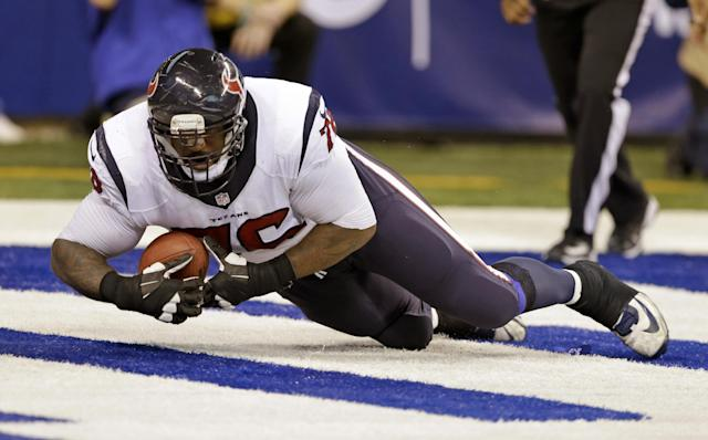 Houston Texans tackle Duane Brown recovers a fumble by quarterback Case Keenum in their own end zone giving the Indianapolis Colts a safety during the second half of an NFL football game in Indianapolis, Sunday, Dec. 15, 2013. (AP Photo/Darron Cummings)