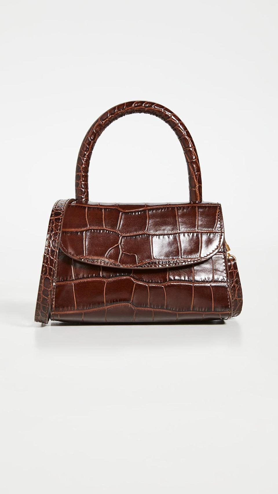 <p>This chocolate brown <span>By Far Mini Nutella Croco Top Handle Bag</span> ($562) fits just the essentials, and is so chic and compact.</p>