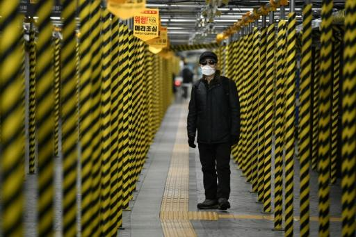 A man walks at a subway station that is being renovated in Seoul on February 22