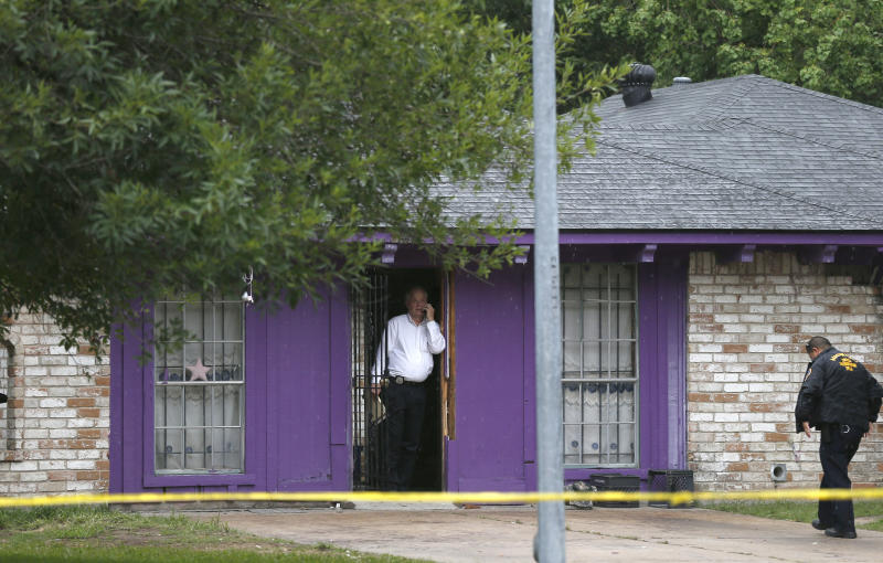 Authorities investigate a home Friday, July 19, 2013, in Houston where police say four homeless men were found in deplorable conditions. Officers who responded to a call expressing concern said said they found three men locked in a garage and a fourth in the home who were malnourished and may have been being held so a captor could cash checks the men were receiving. One person was taken into custody. (AP Photo/Pat Sullivan)