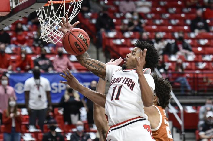 Texas Tech's Kyler Edwards (11) reaches for a rebound during the first half of an NCAA college basketball game against Texas in Lubbock, Texas, Saturday, Feb. 27, 2021. (AP Photo/Justin Rex)