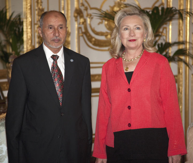 Secretary of State Hillary Rodham Clinton poses for photographs with Libyan Transitional National Council chairman Mustafa Abdel Jalil, Thursday, Sept. 1, 2011, in Paris.  (AP Photo/Evan Vucci, Pool)