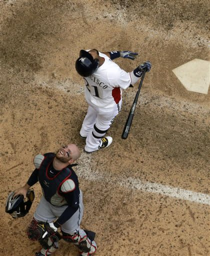 Atlanta Braves catcher Brian McCann, bottom, looks up at a pop-up by Milwaukee Brewers' Juan Francisco, top, with the bases loaded and two outs during the seventh inning of a baseball game on Sunday, June 23, 2013, in Milwaukee. Francisco was out on the play. (AP Photo/Morry Gash)
