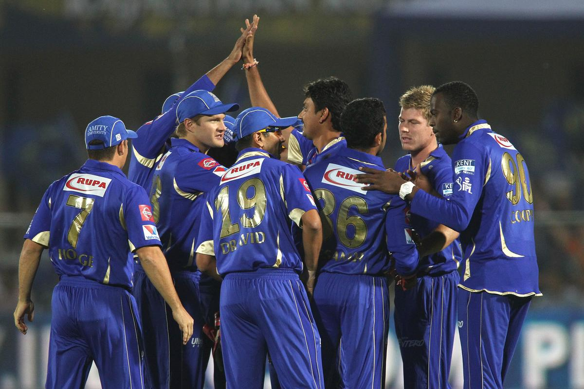 Siddharth Trivedi of Rajasthan Royals is congratulated for getting Kings XI Punjab captain Adam Gilchrist wicket  during match 18 of the Pepsi Indian Premier League (IPL) 2013 between The Rajasthan Royals and the Kings Xi Punjab held at the Sawai Mansingh Stadium in Jaipur on the 14th April 2013. (BCCI)