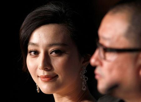 "FILE PHOTO: Director Wang Xiaoshuai (R) and cast member Fan Bingbing attend a news conference for the film ""Rizhao Chongqing"" at the 63rd Cannes Film Festival, France May 13, 2010. REUTERS/Yves Herman/File Photo"