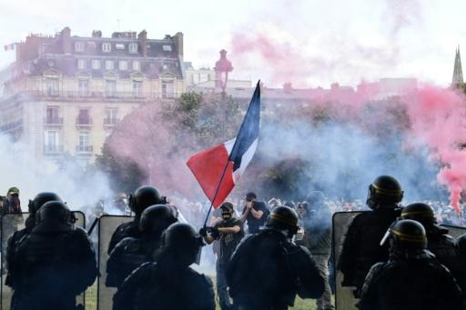 Tear gas hovers at the Les Invalides complex in central Paris during the protest