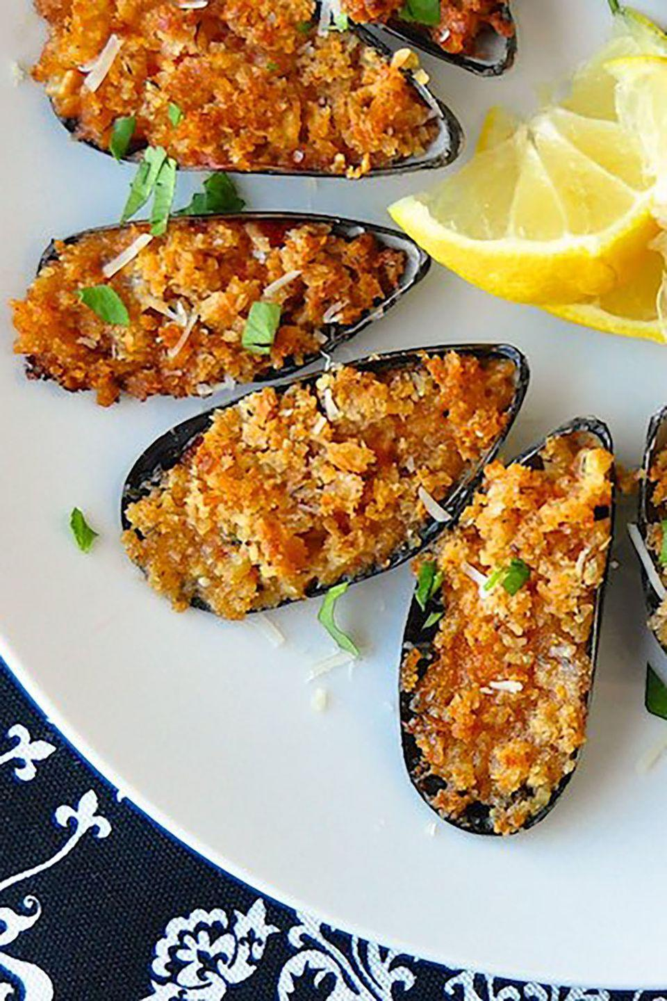 """<p>If you're planning a multi-course meal for your significant other, let the night begin with these tasty mussels, which can be prepared in advance and baked when ready for just 15 minutes.</p><p><strong>Get the recipe at <a href=""""https://www.rockrecipes.com/parmesan-marinara-baked-mussels/"""" rel=""""nofollow noopener"""" target=""""_blank"""" data-ylk=""""slk:Rock Recipes"""" class=""""link rapid-noclick-resp"""">Rock Recipes</a>.</strong></p>"""