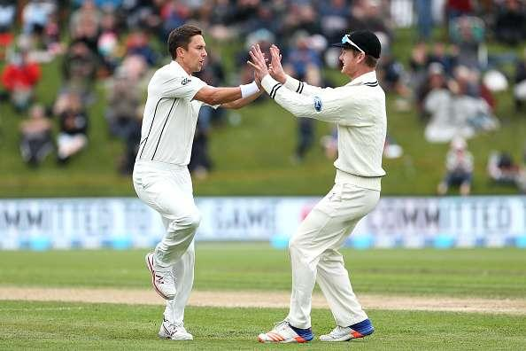DUNEDIN, NEW ZEALAND - MARCH 10: Trent Boult (L) and Jimmy Neesham of New Zealand celebrate the dismissal of Stephen Cook of South Africa during day three of the First Test match between New Zealand and South Africa at University Oval on March 10, 2017 in Dunedin, New Zealand. (Photo by Dianne Manson/Getty Images)