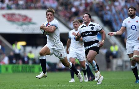 Rugby Union - England v Barbarians, Twickenham Stadium, London, Britain - May 27, 2018 England's Piers Francis breaks through to score their fourth try Action Images via Reuters/Tony O'Brien