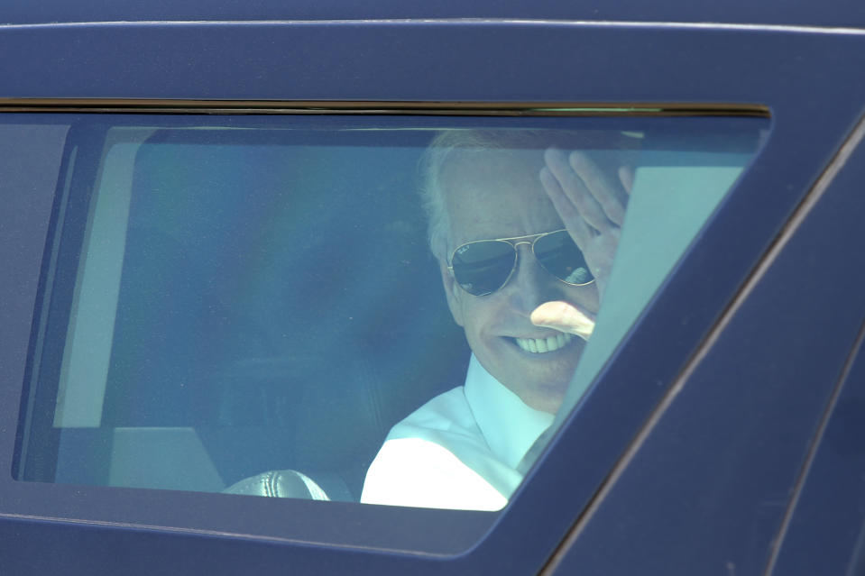 OAKLAND, CALIFORNIA - APRIL 10: Vice President Joe Biden waves goodbye as his motorcade leaves after his remarks on the importance of workforce development and investing in job-training programs during a visit to a Pacific Gas and Electric Company service center in Oakland, Calif., April 10, 2015. PG&E's PowerPathway program is helping workers obtain skills for entry-level positions in the utility industry. Since the program's debut in 2008, 600 individuals have graduated from the program, including 300 veterans, and 80 percent have been hired into PG&E or the utility industry. (Photo by Anda Chu/MediaNews Group/East Bay Times via Getty Images)