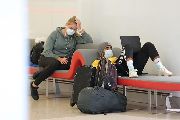 Passengers relax waiting for their flights at the Virgin Australia domestic terminal in Perth