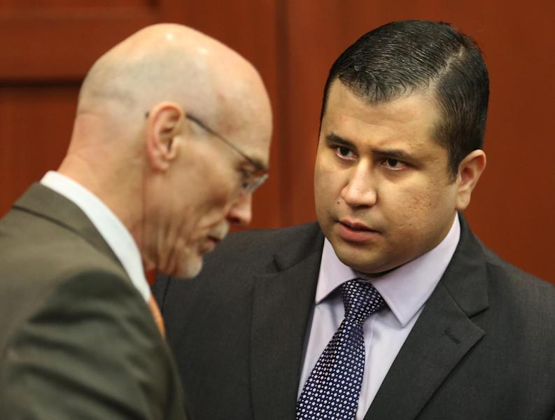 George Zimmerman, right, speaks with defense counsel Don West after the jury leaves the courtroom for more deliberations, in the 25th day of his trial at the Seminole County Criminal Justice Center, in Sanford, Fla., Saturday, July 13, 2013. Zimmerman has been charged in the 2012 shooting death of Trayvon Martin. (AP Photo/Orlando Sentinel, Joe Burbank, Pool)