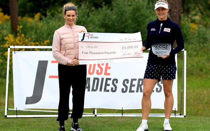 Charley Hull of England receives the winner's cheque from Kate Rose, wife of Justin Rose, after a play-off victory over Liz Young in The Rose Ladies Series at Brockenhurst Manor Golf Club on June 18, 2020 - Andrew Redington/Getty Images