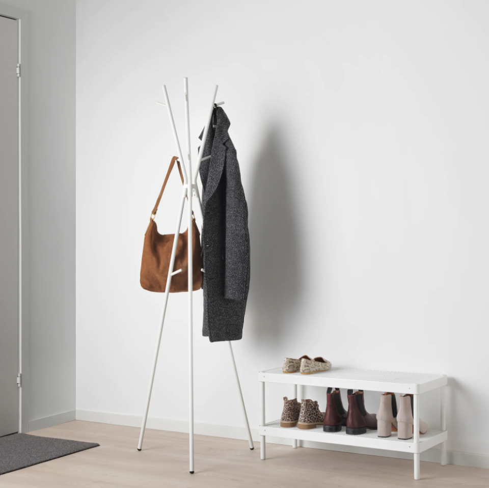 """<p>You may already have a front-hall coat closet, but don't rule out a coat rack for the outwear you don the most. Or forgo a console and use one to hang your bags instead.</p><p><a class=""""link rapid-noclick-resp"""" href=""""https://go.redirectingat.com?id=74968X1596630&url=https%3A%2F%2Fwww.ikea.com%2Fus%2Fen%2Fp%2Fekrar-hat-and-coat-stand-white-10415594%2F&sref=https%3A%2F%2Fwww.countryliving.com%2Fhome-maintenance%2Fg37186772%2Fentryway-ikea-hacks%2F"""" rel=""""nofollow noopener"""" target=""""_blank"""" data-ylk=""""slk:BUY NOW"""">BUY NOW</a> <strong><em>Coat Rack, $20</em></strong></p>"""
