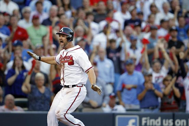 Atlanta Braves catcher David Ross comes through home plate on teammate Andrelton Simmons' bunt during the fourth inning of the National League wild card playoff baseball game against the St. Louis Cardinals, Friday, Oct. 5, 2012, in Atlanta. Simmons' bunt was ruled out and Ross went back to first base. (AP Photo/John Bazemore)
