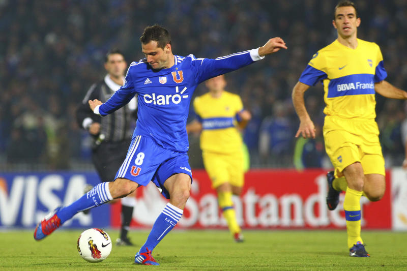 SANTIAGO, CHILE - JUNE 21: Guillermo Marino, of Universidad de Chile, kicks the ball during the second leg of the Libertadores Cup 2012 semifinals between Universidad de Chile and Boca Juniors at the National Stadium on June 21, 2012 in Santiago, Chile. (Photo by Max Montecinos/LatinContent via Getty Images)