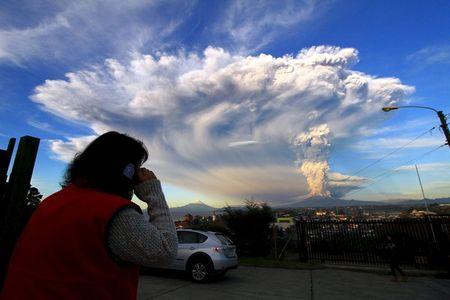 Smoke and ash rise from the Calbuco volcano, seen from Puerto Varas city