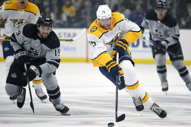 Nashville Predators right wing Craig Smith, right front, moves the puck as Los Angeles Kings left wing Alex Iafallo, left, gives chase during the first period of an NHL hockey game Saturday, Jan. 4, 2020, in Los Angeles. (AP Photo/Mark J. Terrill)