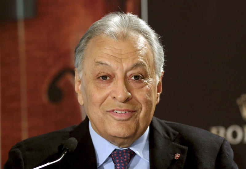 "FILE - In the Dec. 29, 2014 file photo, Maestro Zubin Mehta speaks during a press conference in Vienna, Austria. When Mehta joined the Israel Philharmonic Orchestra in 1969, Lahav Shani wasn't even alive. Now, at the age of 30, the Israeli wunderkind is poised to succeed his mentor at the helm of the acclaimed symphony. Mehta, 83, is set to step down late this year after leading the orchestra for half a century and serving as its ""music director for life"" since 1981. (AP Photo/Ronald Zak, File)"