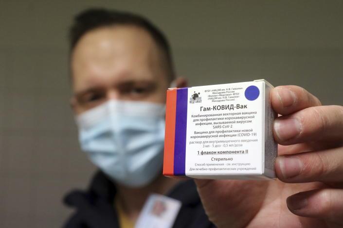 A pharmacist holds a packet of Sputnik V vaccines to be used for the first dose in the pharmacy of the Borsod-Abauj-Zemplen County Medical Center and University Teaching Hospital in Miskolc, Hungary, Tuesday, March 9, 2021. (Janos Vajda/MTI via AP)