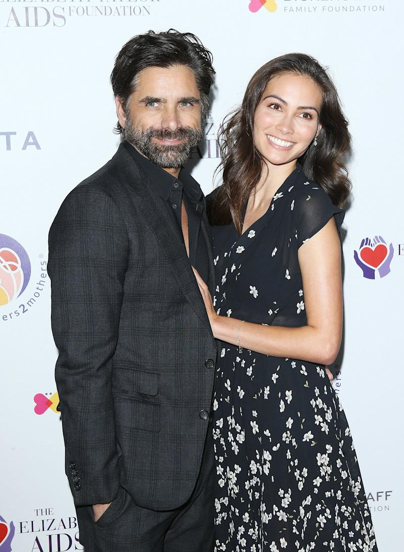 John Stamos and Caitlin McHugh pictured together in October.