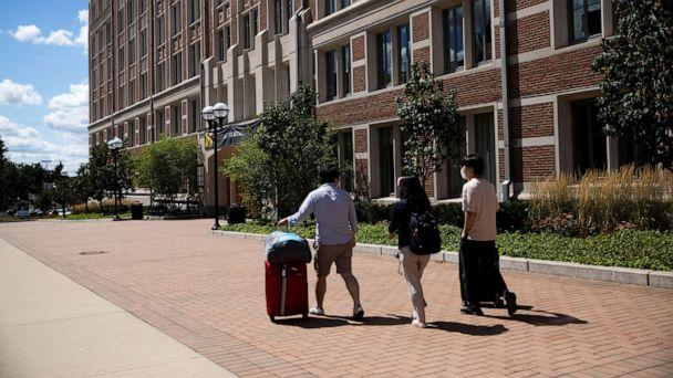 PHOTO: In this Aug. 19, 2020, file photo, students move back into the dorm for fall semester at the University of Michigan campus, amid the COVID-19 outbreak, in Ann Arbor, Mich. (Emily Elconin/Reuters, FILE)