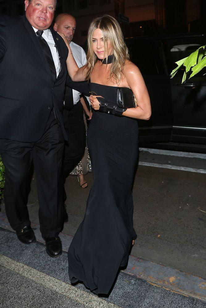Jennifer Aniston Arrives Solo And Sports Wrist Brace For Gwyneth