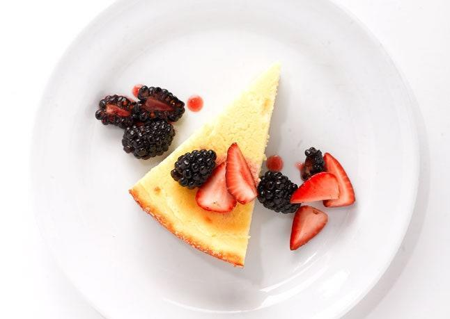 """This tangy, crustless cheesecake feels light and airy thanks to the addition of beaten egg whites. <a href=""""https://www.bonappetit.com/recipe/goat-cheese-cake-with-mixed-berries?mbid=synd_yahoo_rss"""" rel=""""nofollow noopener"""" target=""""_blank"""" data-ylk=""""slk:See recipe."""" class=""""link rapid-noclick-resp"""">See recipe.</a>"""