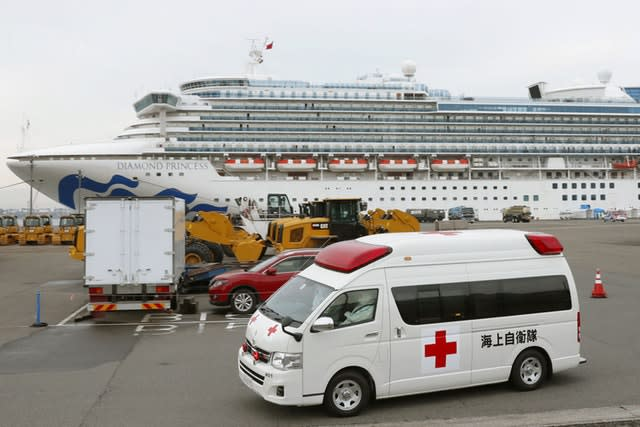 An ambulance leaves Yokohama Port where the Diamond Princess is docked