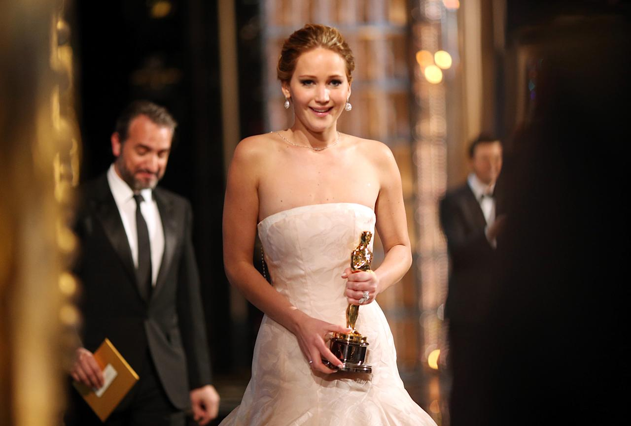 Jennifer Lawrence onstage after winning the award for Actress in a Leading Role during the Oscars held at the Dolby Theatre on February 24, 2013 in Hollywood, California.  (Photo by Christopher Polk/Getty Images)