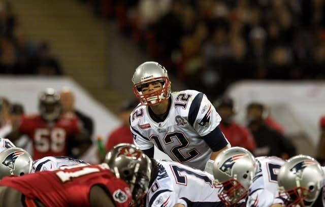 Tom Brady might have to wait to start life with the Buccaneers (Clive Gee/PA)