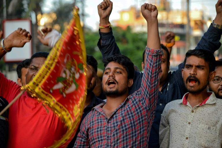 In Guwahati, India, activists from the religious organizations Antar Rashtriya Hindu Parishad and Rashtriya Bajrang Dal shout slogans to celebrate after the Indian government's revocation of special autonomy for Indian-administered Kashmir (AFP Photo/Biju BORO)
